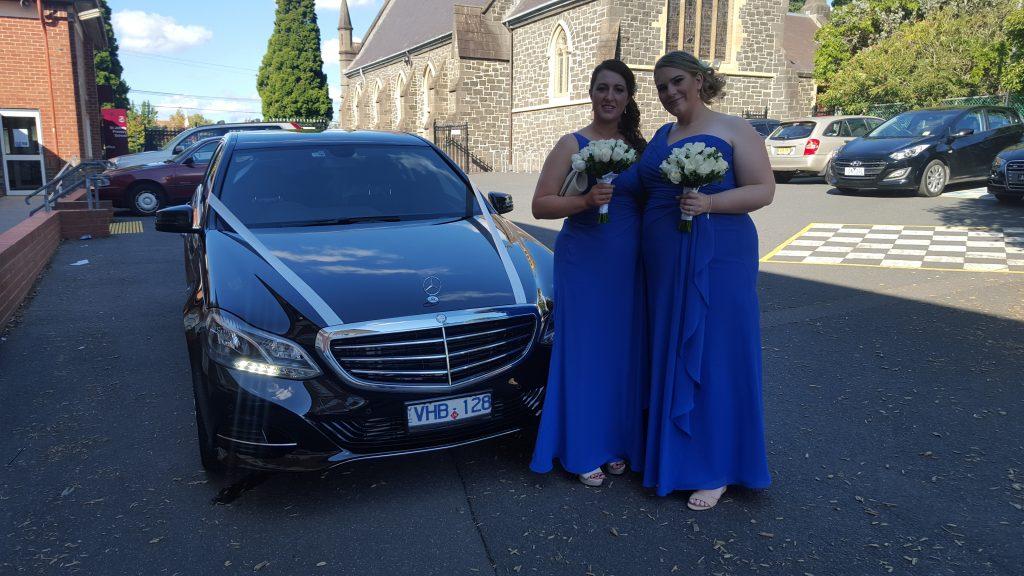 Bride maids in front of Mercedes wedding car Parkville